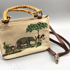 Relic bamboo handle beaded elephant mini bag